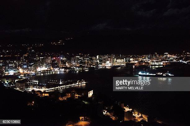 Ships head out into the harbour in Wellington on early November 14 following an earthquake centred some 90 kilometres north of New Zealand's South...