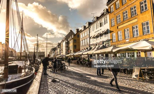 ships in nyhavn at sunset, copenhagen, denmark - nyhavn stock pictures, royalty-free photos & images