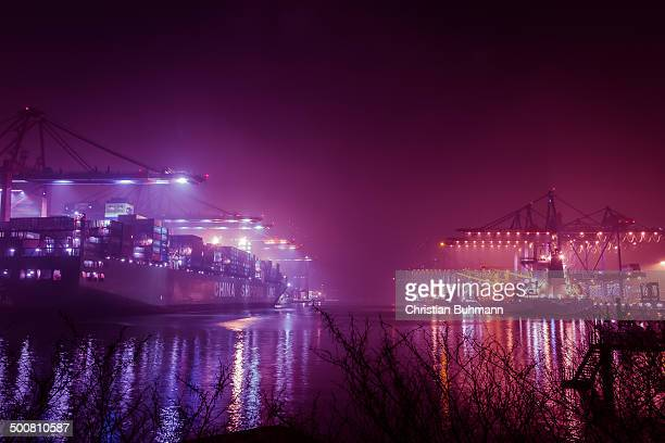 CONTENT] Ships in the harbor at night while foggy weather