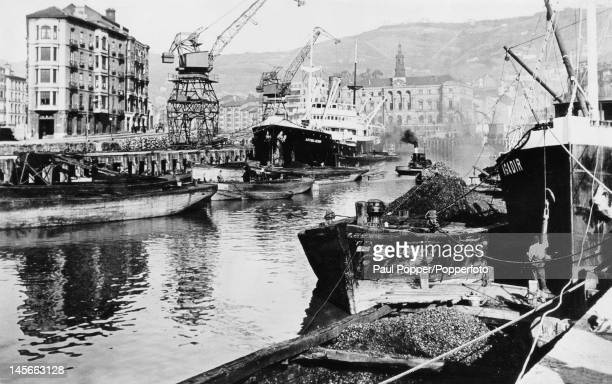 Ships in the ore docks at the port of Bilbao Spain circa 1925