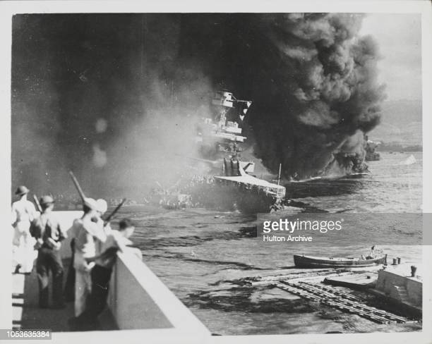 Ships of the US Pacific Fleet on fire during the Attack by Japanese forces, on Pearl Harbor in Honolulu, Oahu, Hawaii, December 7, 1941.