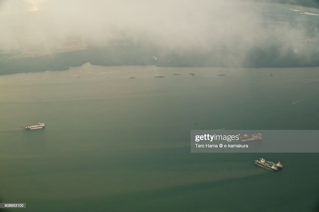 Ships on Johor Strait in Malaysia day time aerial view from airplane : Stock-Foto