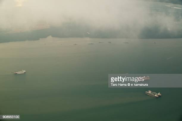 Ships on Johor Strait in Malaysia day time aerial view from airplane