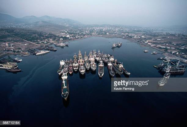 ships rafted together in pireaus harbor - piraeus stock photos and pictures
