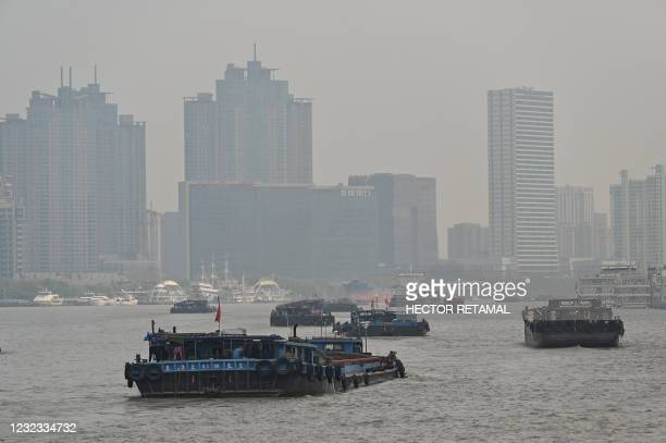 Ships sail on the Huangpu River in Shanghai on April 16, 2021.
