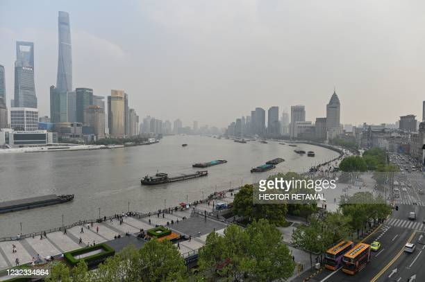 Ships sail on the Huangpu River running along the financial district of Shanghai on April 16, 2021.