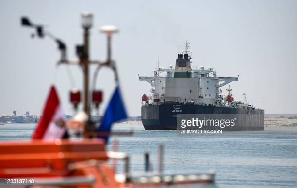Ships sail through the Suez Canal in the northeastern Egyptian city of Ismailiya, on May 27, 2021. - Talks about compensations with the owner of the...