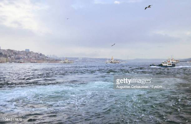 ships sailing on sea against sky - cetkauskas stock pictures, royalty-free photos & images