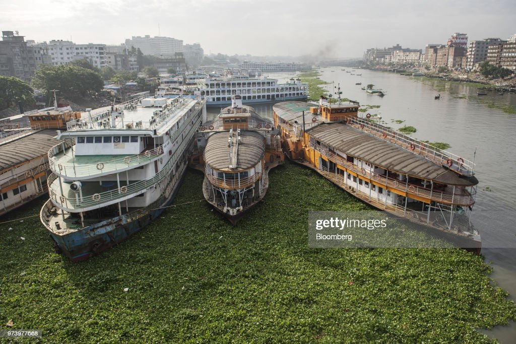 Ships sit moored at the Sadarghat boat terminal in Dhaka, Bangladesh, on Wednesday, June 6, 2018. The Bangladesh economy will expand 6.9% this financial year and 6.8% in 2019, according to asurveyconducted by Bloomberg News. Photographer: Ismail Ferdous/Bloomberg via Getty Images