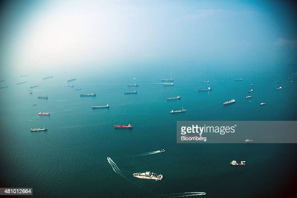 Ships sit offshore in the Singapore Strait in this aerial photograph taken above Singapore on Thursday July 2 2015 Singapore's economy contracted...