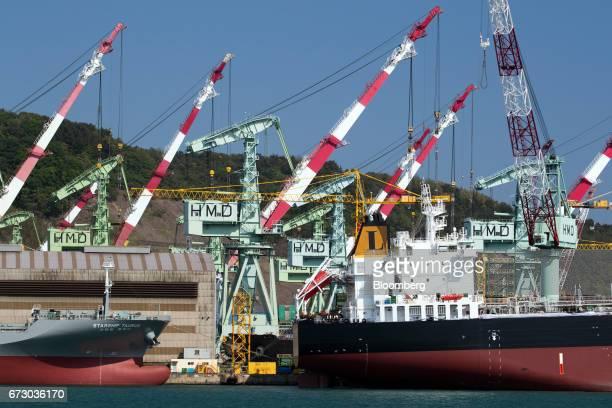 Ships sit under construction at a shipyard of Hyundai Mipo Dockyard Co., an affiliate of Hyundai Heavy Industries Co., in Ulsan, South Korea, on...