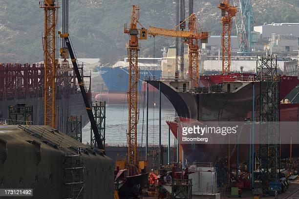 Ships sit under construction at the Hyundai Heavy Industries Co shipyard in Ulsan South Korea on Wednesday July 3 2013 Hyundai Heavy Industries the...