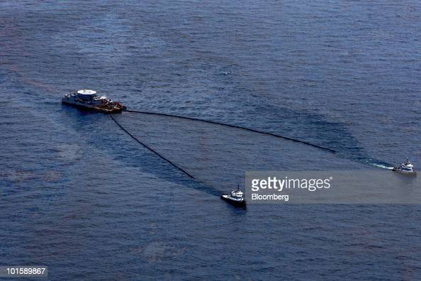 Ships skim oil from the water's surface near the BP