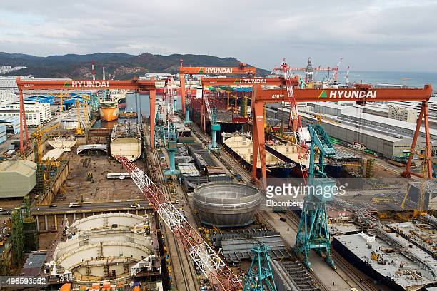 Ships stand under construction in the dry dock at the Hyundai Heavy Industries Co. Shipyard in Ulsan, South Korea, on Tuesday, Nov. 10, 2015....