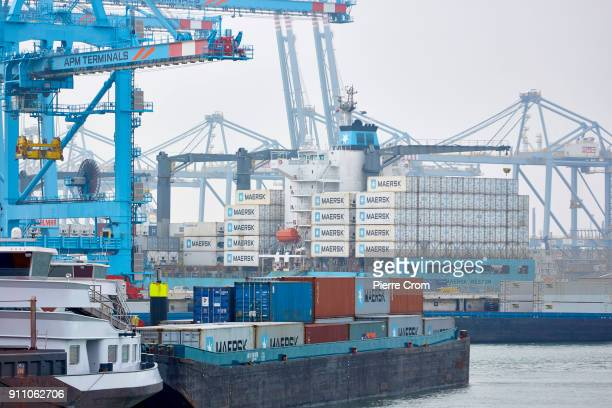 Ships transporting shipping containers are seen maneuvering in the Port of Rotterdam the largest port in Europe in Rotterdam on January 27 2018...