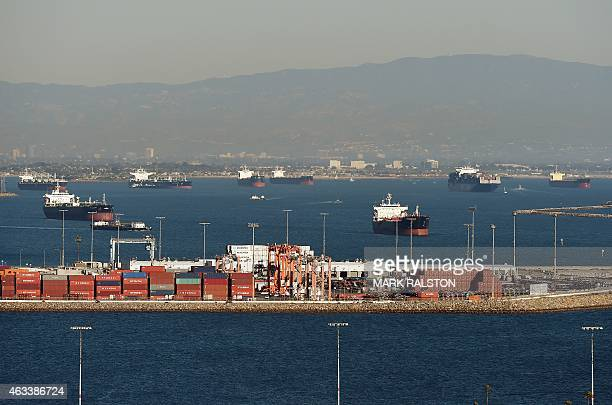 Ships wait to be loaded at the Port of Los Angeles in Long Beach on February 13 2015 US West Coast ports have partially closed due to a dispute...
