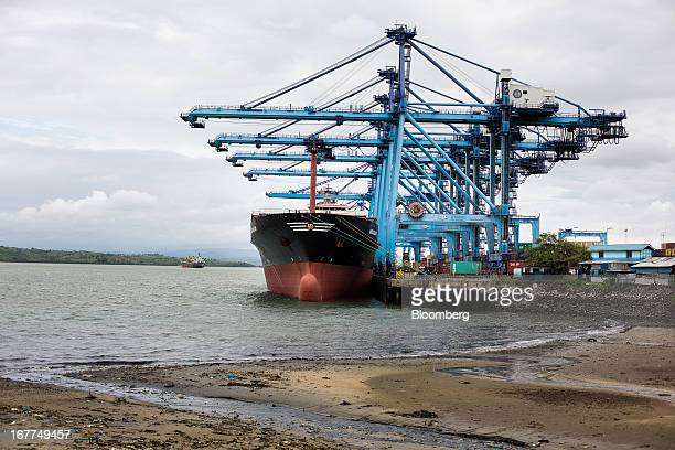 Shiptoshore container cranes manufactured by Shanghai Zhenhua Heavy Industry Co Ltd stand over the MSC Nilgun operated by Mediterranean Shipping Co...