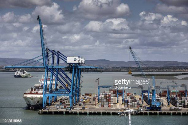 Ship-to-shore crane loads containers onto a ship at Mombasa port, operated by Kenya Ports Authority, in Mombasa, Kenya, on Saturday, Sept. 1, 2018....