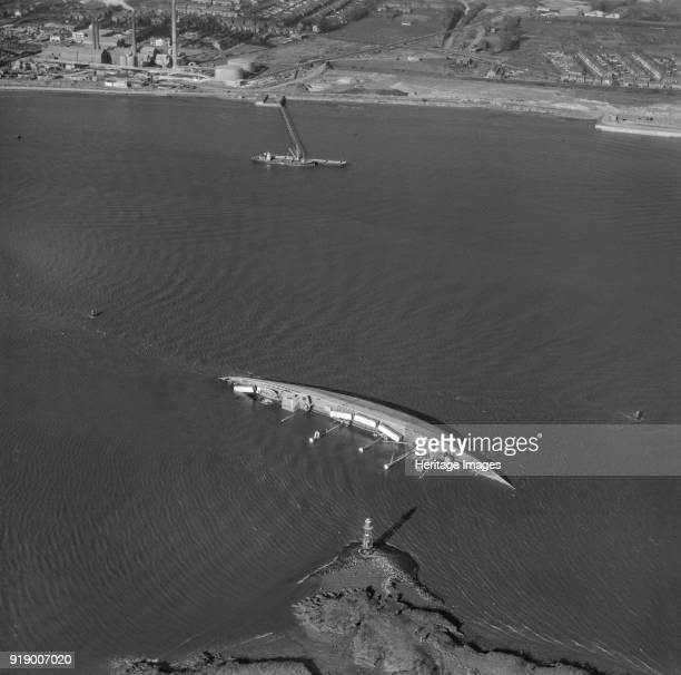 Shipwreck at Fiddler's Reach on the River Thames London November 1964 The capsized German cargo vessel 'Magdeburg' laden with buses bound for Cuba A...