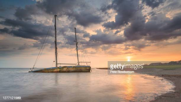 shipwreck in lytham bay at sunset - sailing stock pictures, royalty-free photos & images