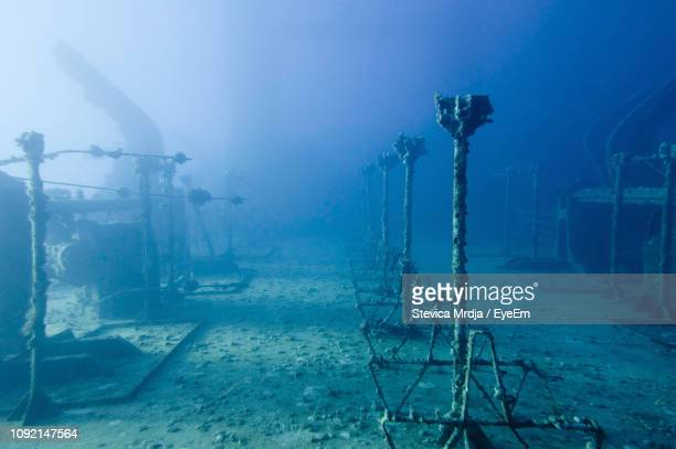 shipwreck in sea - sunken stock pictures, royalty-free photos & images