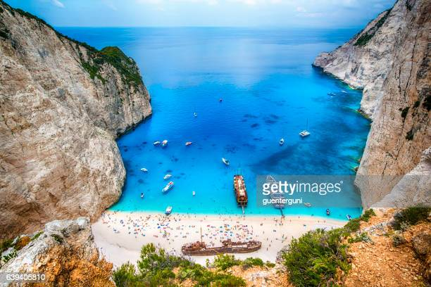 shipwreck in the famous navagio bay, zakynthos island, greece - greece stock pictures, royalty-free photos & images
