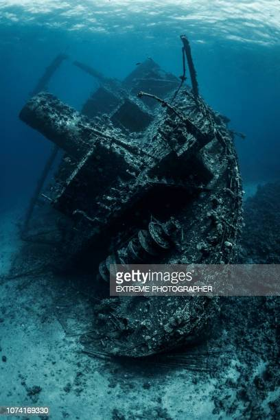 shipwreck lying at the bottom of the red sea completely covered by seaweed and corals - sunken stock pictures, royalty-free photos & images