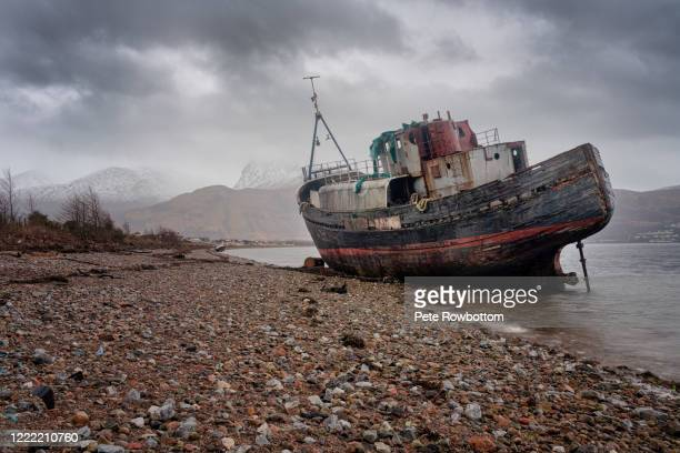 shipwreck on the shore - abandoned stock pictures, royalty-free photos & images