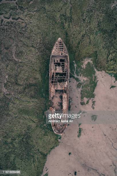 shipwreck photographed by drone, gillingham, united kingdom - gillingham stock pictures, royalty-free photos & images