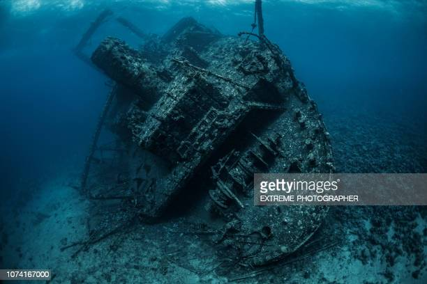 shipwreck rusted and covered with corals and sea life lying on the bottom of the red sea - sunken stock pictures, royalty-free photos & images