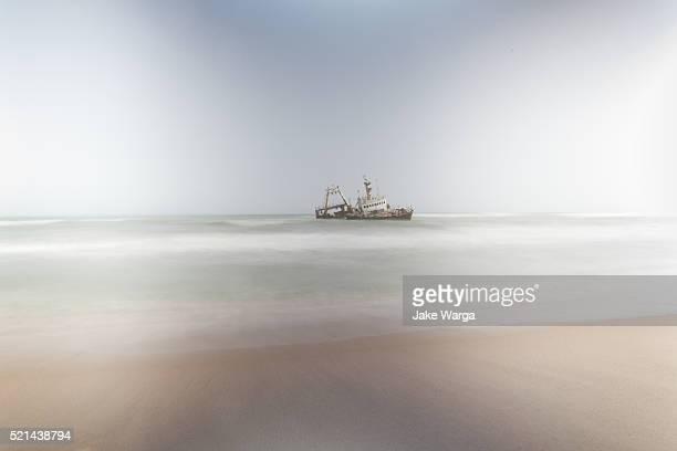 shipwreck, skeleton coast, namibia - jake warga stock pictures, royalty-free photos & images