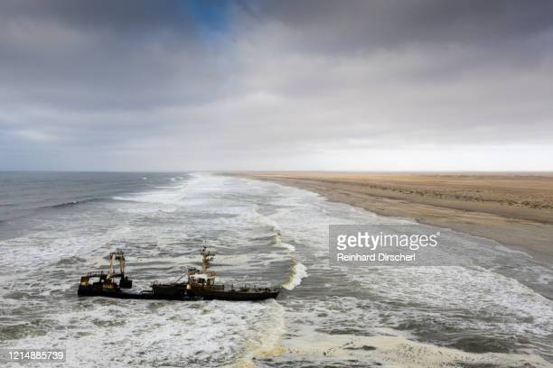 shipwreck zeila at skeleton coast, henties bay, namibia - sunken stock pictures, royalty-free photos & images