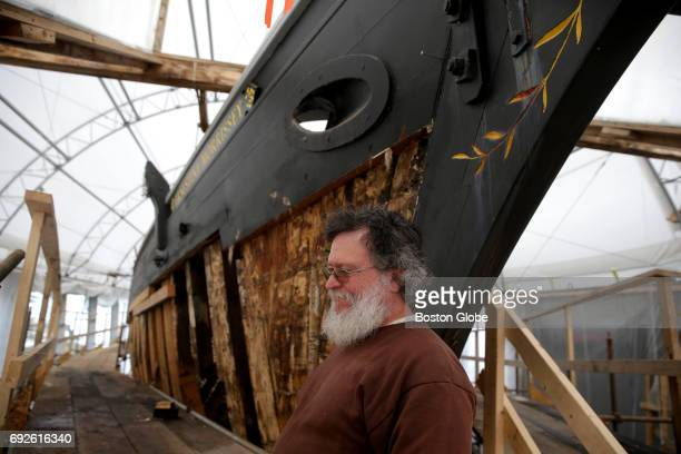 Shipwright and project manager David Short who is leading efforts to restore the Schooner ErnestinaMorrissey stands next to the vessel in Boothbay...
