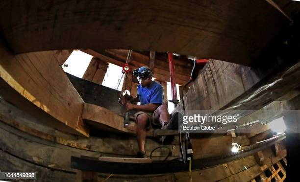 Shipwright Louie Marandola works with a wood chisel and mallet under deck as the Mayflower II the 60yearold replica of the Pilgrim ship undergoes a...