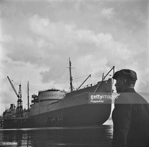 Shipwright Tom McGouldrick views the recently completed tanker ship Athelvictor at the Caledon shipyard in Dundee, Scotland during World War II in...