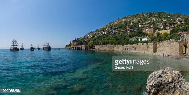Shipyard (Tersane) and the ruins of a medieval fortress (Alanya Castle) on the mountainside. Panoram