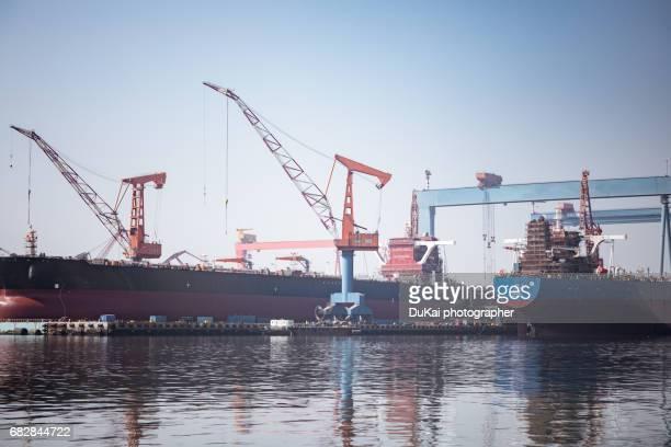 shipyard cranes - dalian stock photos and pictures
