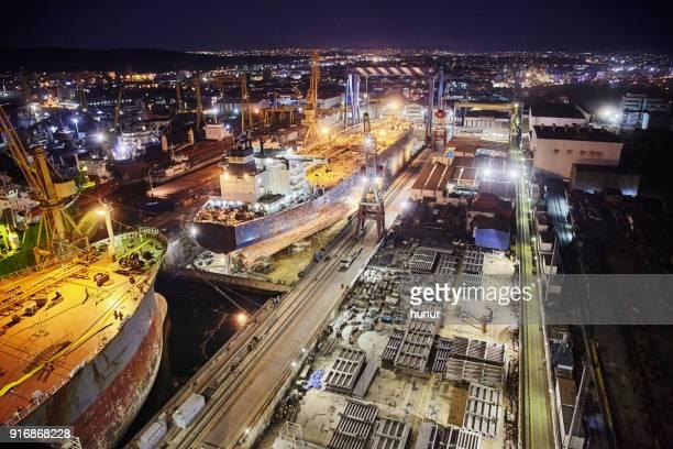 shipyard maintenance at night - shipyard stock pictures, royalty-free photos & images