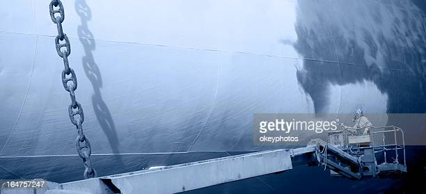 Shipyard worker paint the ship
