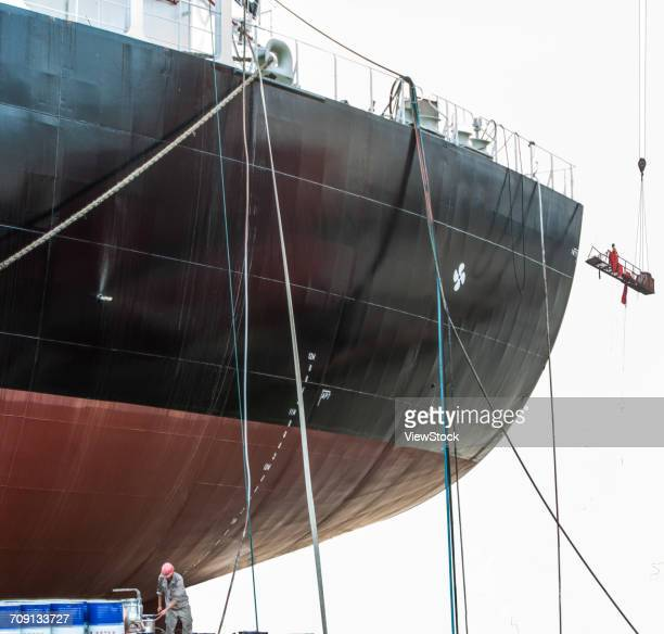 shipyard worker - industrial sailing craft stock pictures, royalty-free photos & images