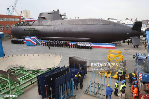 Shipyard workers attend the christening ceremony of a German Navy submarine of the class 212A at the shipyard of ThyssenKrupp Marine Systems in Kiel...