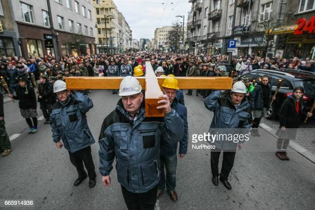 Shipyard workers attending the Way of the Cross procession are seen on 7 April 2017 in Gdynia Poland Way of the Cross also known as Way of Sorrows or...