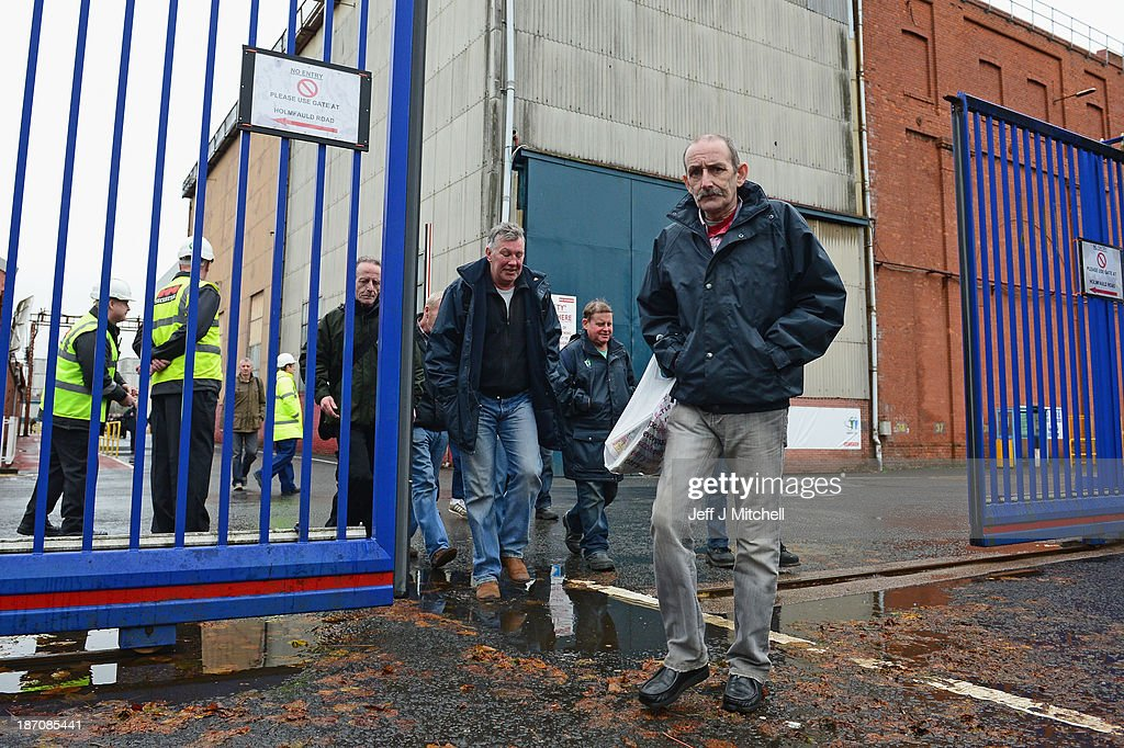 Shipyard workers leave the BAE systems yard in Govan following the announcement that the company will be cutting jobs on November 6, 2013 in Glasgow, Scotland. The cuts are being made following a decline in orders, with 1775 jobs going between the yards in Scotland and England with the end of shipbuilding altogether at the Portsmouth yard.