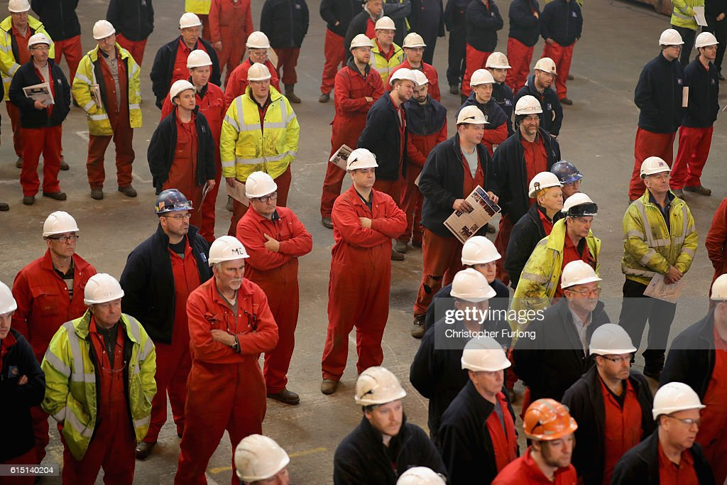 Shipyard workers look on as naturalist Sir David Attenborough takes part in the keel-laying ceremony of the new polar research ship for Britain, RRS Sir David Attenborough, which is named after him, at Cammell Laird shipyard, on October 17, 2016 in Birkenhead, England. World-renowned naturalist and broadcaster Sir David Attenborough initiated the lifting of the first block. The RRS Sir David Attenborough is being built by Cammell Laird and operated by British Antarctic Survey. The new research ship will be one of the most advanced in the world. The keel-laying ceremony is a maritime tradition said to bring luck to the ship during her construction and to the captain and crew during her life.