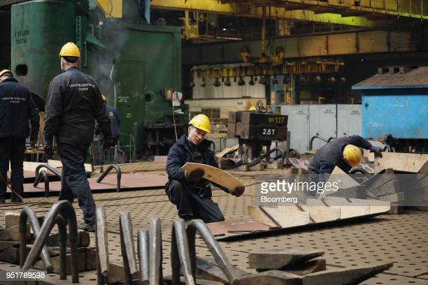 Shipyard workers prepare templates to weld ship sections at the GSG Towers Sp. Z o.o. Factory, a unit of the Gdansk Shipyard Group, in Gdansk,...