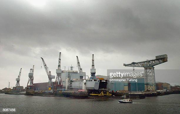 Shipyard workers put the finishing touches to RFA Mounts Bay a new landing ship built for the Royal Navy March 15 at Govan in Glasgow Scotland The...