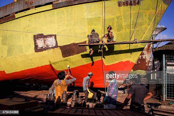 Shipyard workers working on repairing ships and making the propellers of shipThey work hard all day long but still paid minimum wages