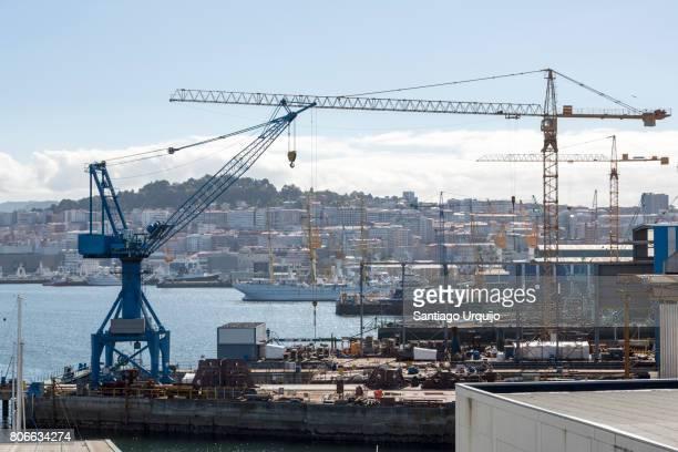 shipyards with city of vigo on background - vigo stock pictures, royalty-free photos & images