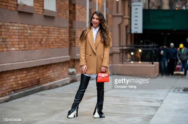 Shir Bar-Yehuda seen wearing red Mulberry bag, beige Zara blazer, flared black pants, ankle boots during New York Fashion Week February 2020 on...