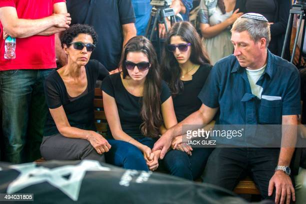 Shira and Ayelet Riva mourn over the bodies of their parents, Emanuel and Miriam, who were killed during the shooting attack at the Jewish Museum in...